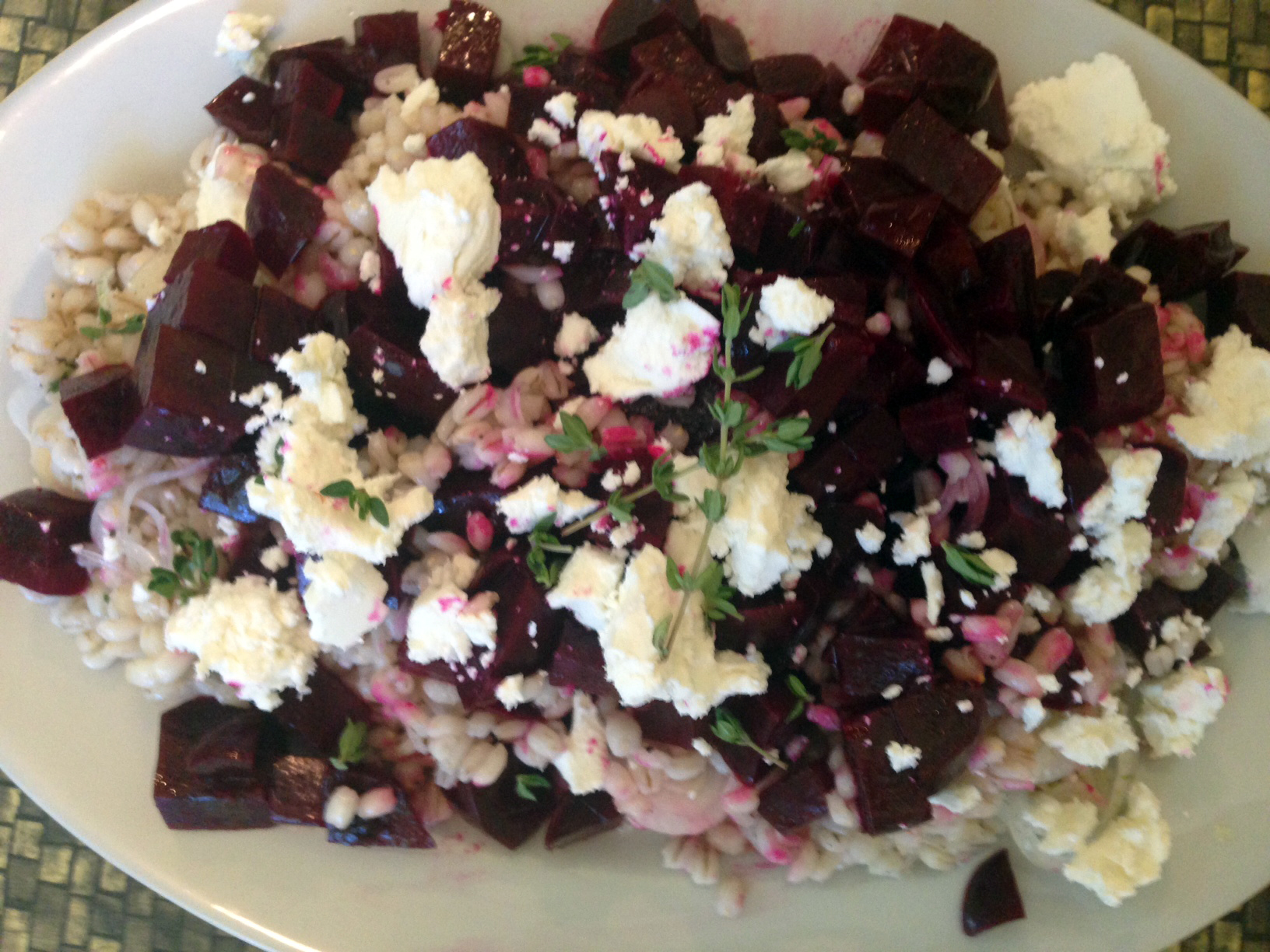 Roasted beet and barley salad with picked spring onions and goat cheese.