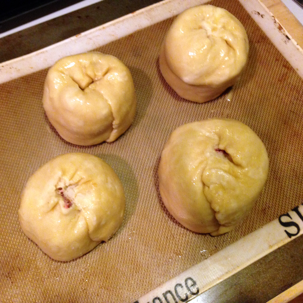 Softball-sized knishes, ready for the oven.