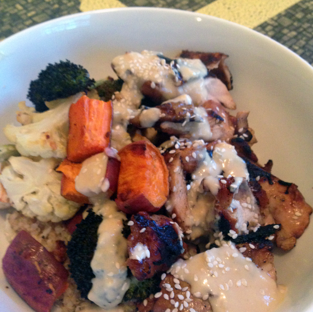 Quinoa, grilled chicken, roasted vegetables, miso-tahini sauce, and sesame seeds.