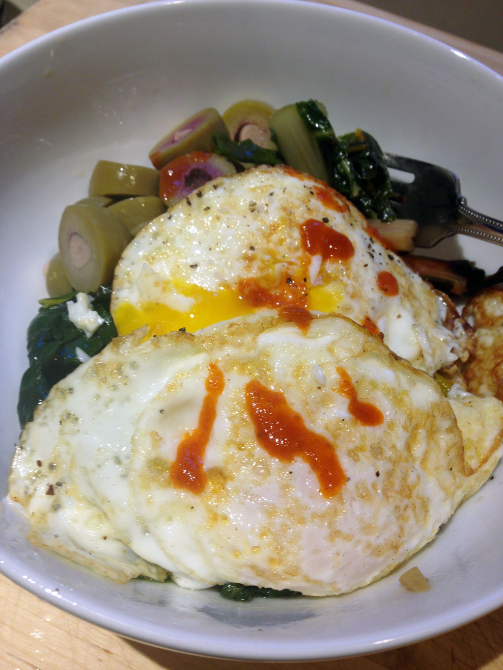 My desperation dinner: brasied chard, sliced olives, eggs, hot sauce.