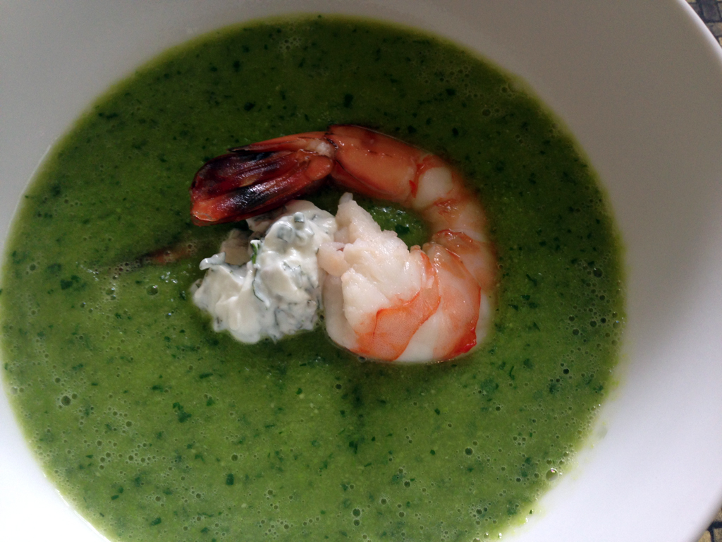 Fresh pea soup with minted yogurt and a beautifully poached shrimp.