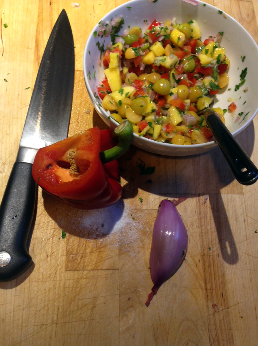 Husk cherry, mango, and pepper salsa. We ate this on chicken tacos.