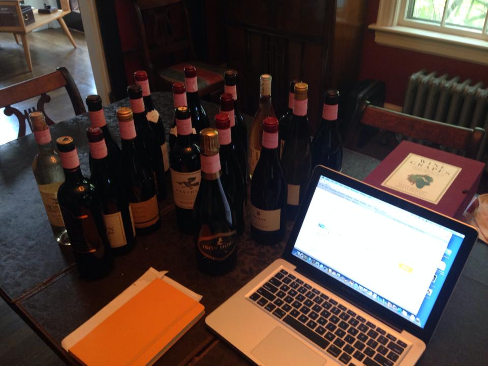 Bottles, logged in the computer and tagged with tasting notes.