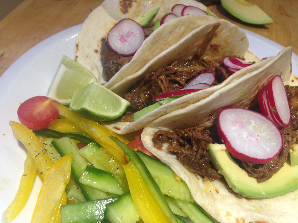 lamb barbacoa tacos with shaved yellow pepper and cucumber slaw