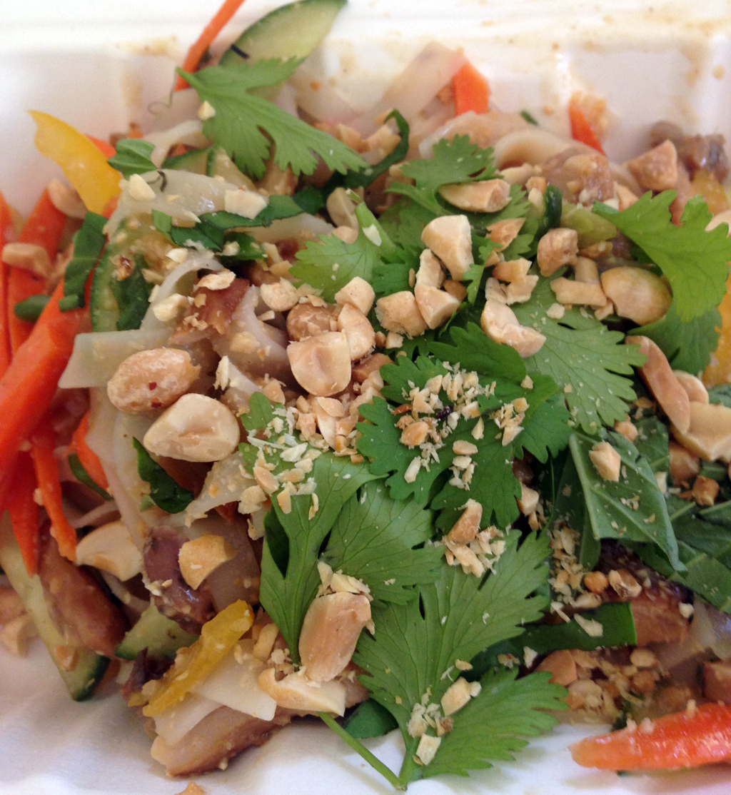 Cold rice noodle salad with pickled vegetables, chicken, peanuts, lime, and herbs.