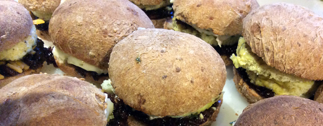 9-grain buns with bacon jam, brie, and summer savory omelet.