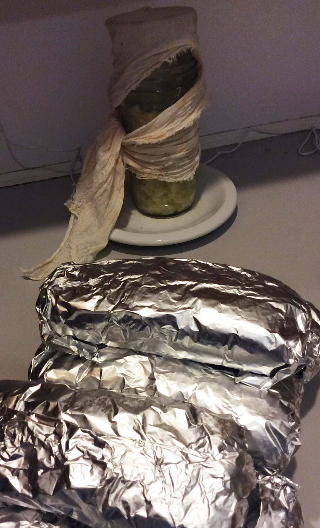 Gym-bound stack o'burritos with a tiny jar of mummy-like sauerkraut fermenting in the background.