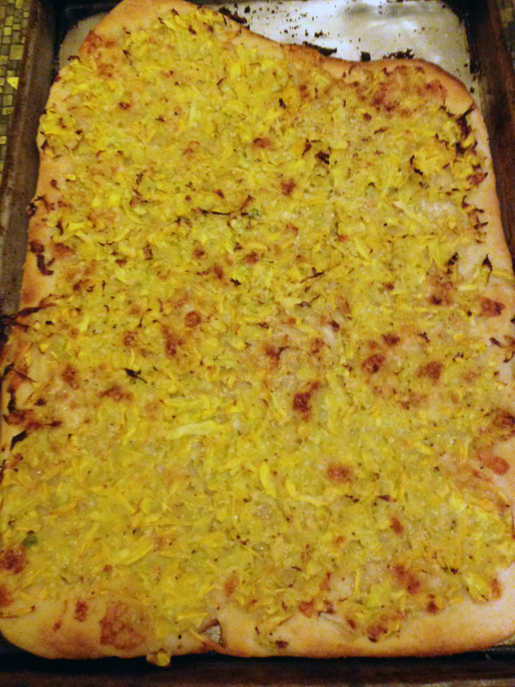 Fluorescent yellow squash pizza.