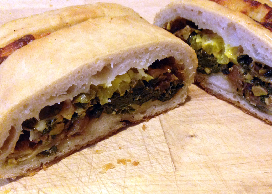 Stromboli, filled with caramelized fennel and onion, kale, fontina, and hot pepperoncini.