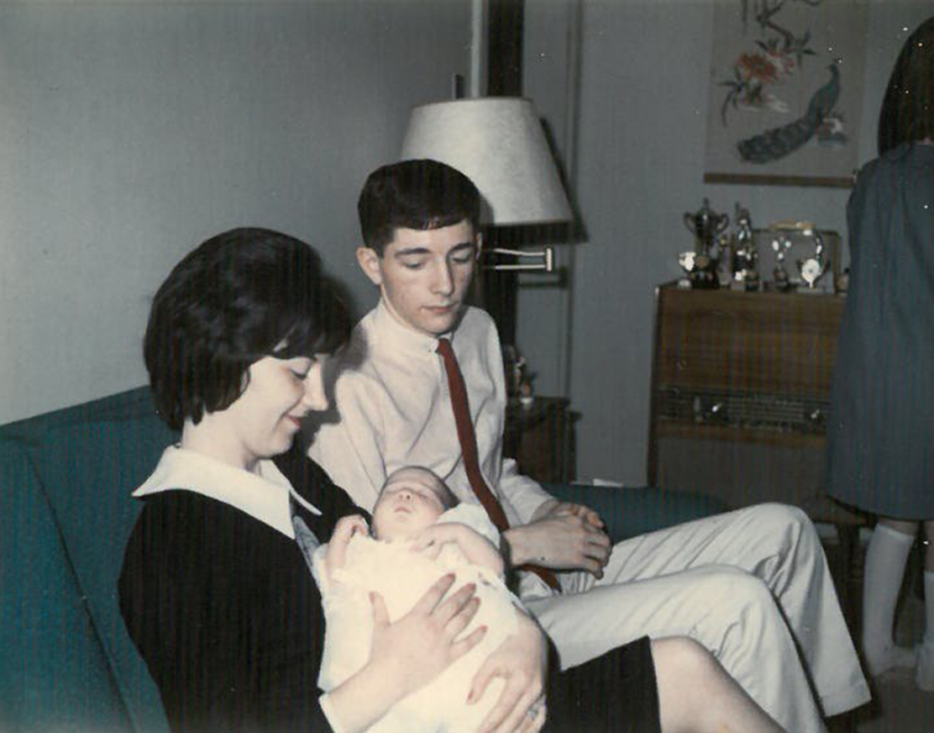 My christening, in which my godmother dotes and my brother/godfather looks as if we wants to hurl.